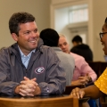 UGA alumni interacts with current student.