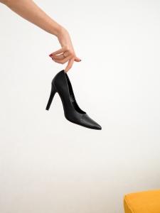 hand holding stiletto pumps