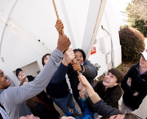 Prospective students ring the Chapel Bell while touring campus