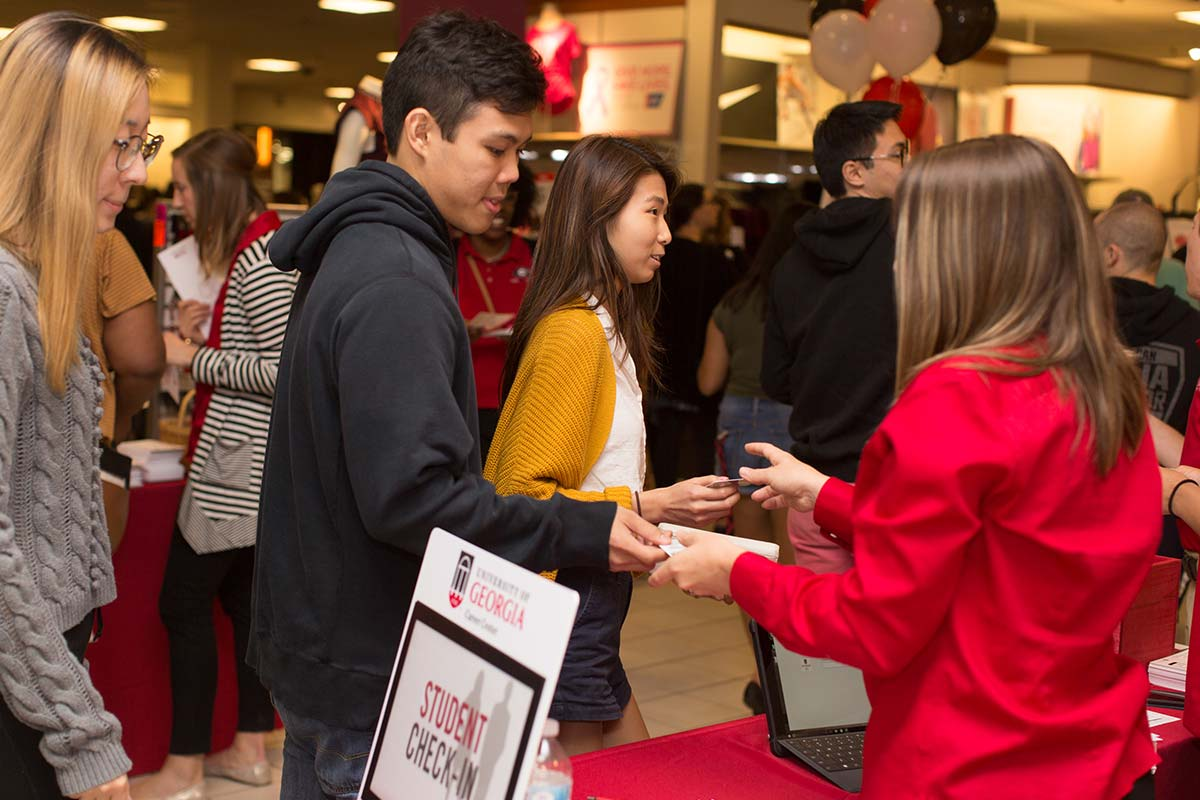 Students checking in at the Spring Suit Up event, where students have the opportunity to get professional clothes at a discount.